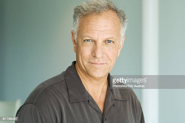 Mature man, smiling at camera, portrait