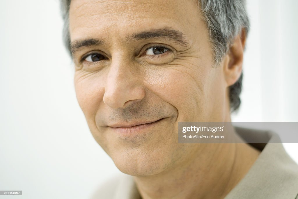 Mature man smiling at camera, portrait : Stock Photo