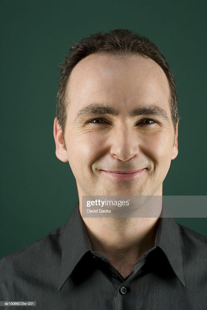 Mature man smiling, close-up, portrait : Stockfoto