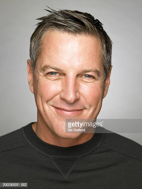 mature man smiling, portrait - handsome 50 year old men stock photos and pictures