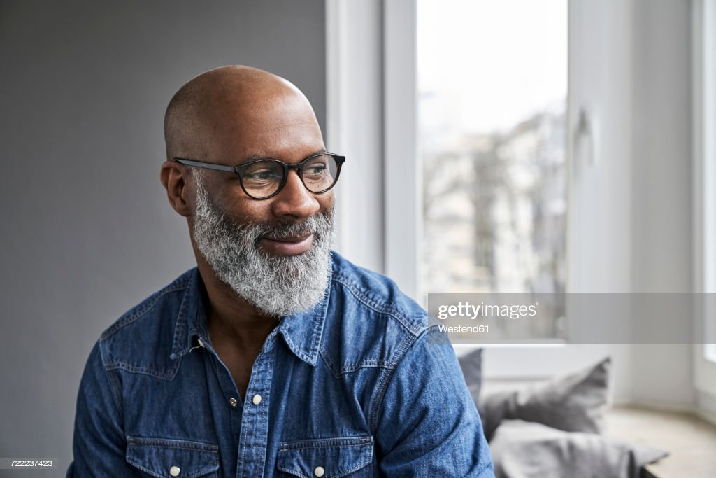 Mature man smiling, portrait : Stock Photo