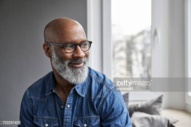 mature man smiling, portrait - bold man stock photos and pictures