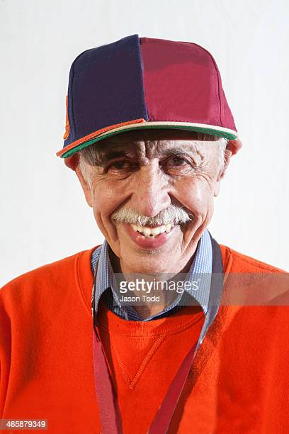 mature man smiling wearing hat on white - jason todd stock photos and pictures