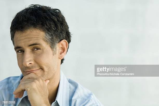 Mature man smirking at camera, portrait