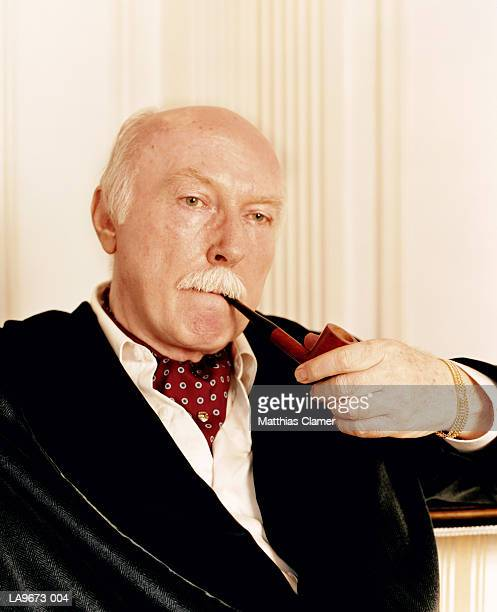 mature man smoking pipe, close-up - smoking jacket stock photos and pictures