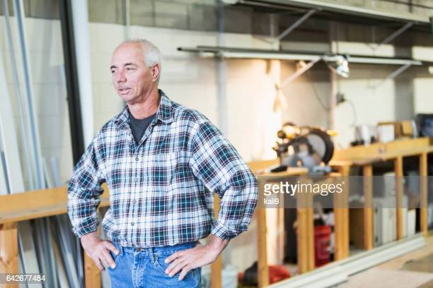 Mature man standing in factory workshop