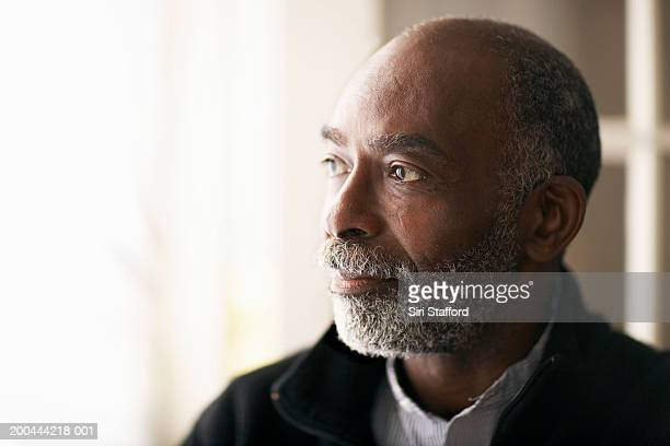 mature man standing in front of open door - 50 59 years stock pictures, royalty-free photos & images