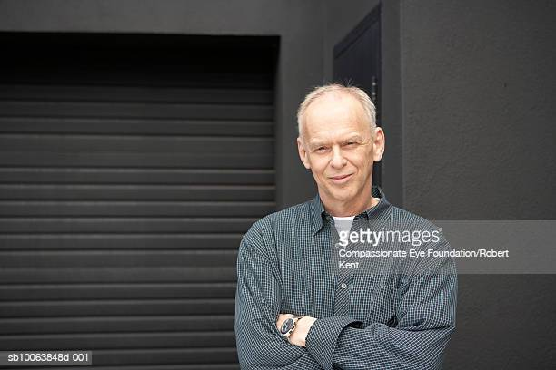 mature man standing outside garage, portrait - cef stock pictures, royalty-free photos & images