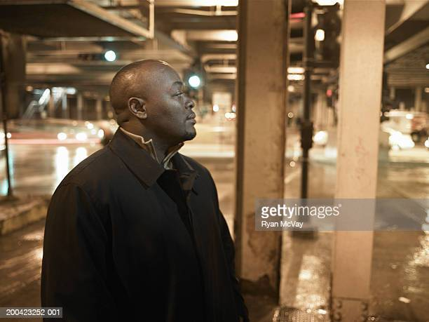 mature man standing under elevated subway tracks - goatee stock pictures, royalty-free photos & images