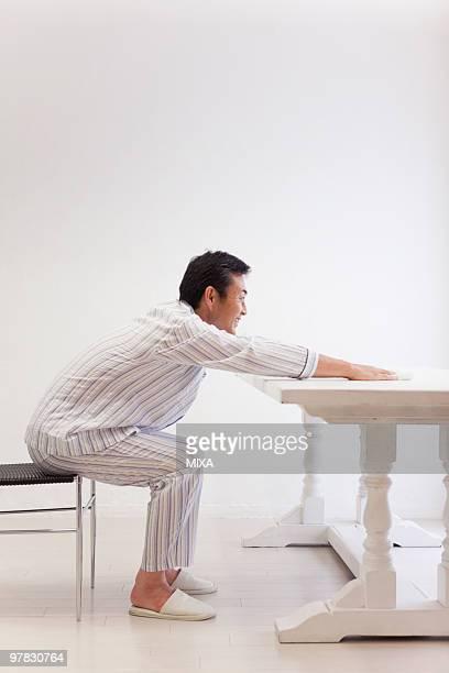 Mature man stretching shoulder