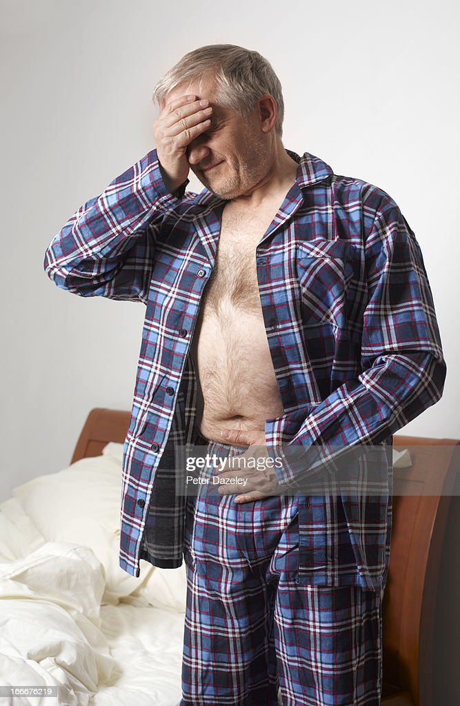 Mature man suffering with stomach pain : Stock Photo