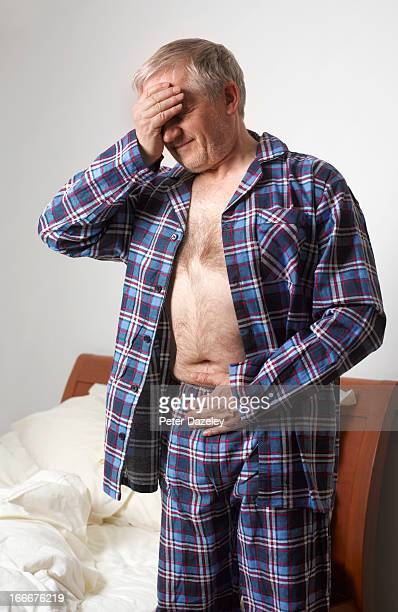 Mature man suffering with stomach pain