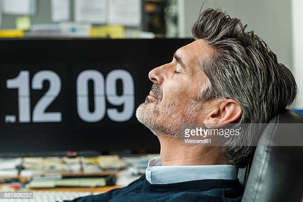 Mature man taking a nap at his office
