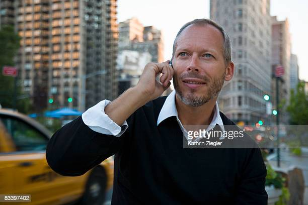 mature man talking on mobile phone - receding hairline stock pictures, royalty-free photos & images