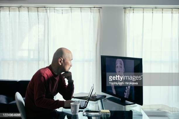 mature man teleworking at home for social distance strategy - disruptagingcollection stock pictures, royalty-free photos & images