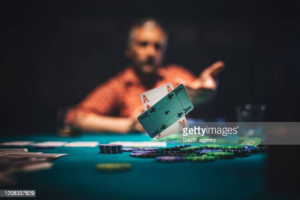 mature man throwing playing cards on table - thinking of you card stock pictures, royalty-free photos & images