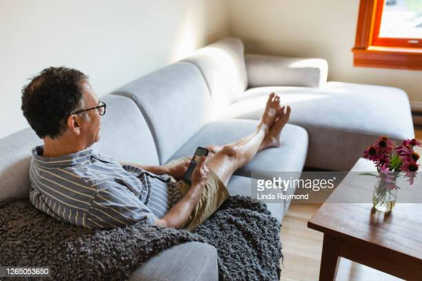 mature man using his mobile phone - 20th century style stock pictures, royalty-free photos & images