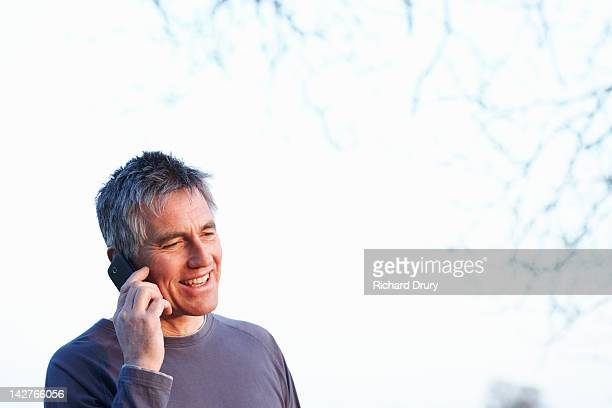 mature man using mobile phone in countryside - richard drury stock pictures, royalty-free photos & images