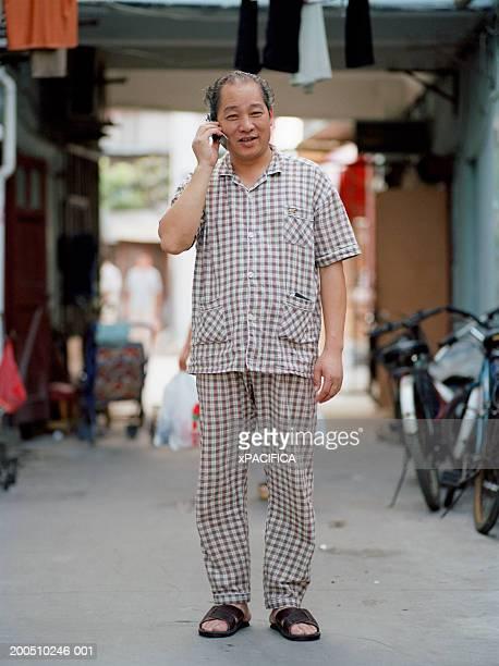 Mature man using mobile phone
