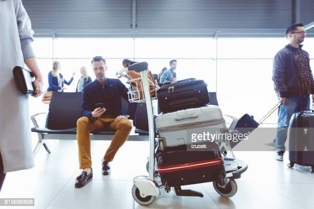 Mature man waiting at airport lounge
