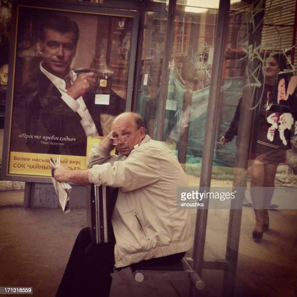 mature man waiting for bus in moscow - brosnan stock photos and pictures
