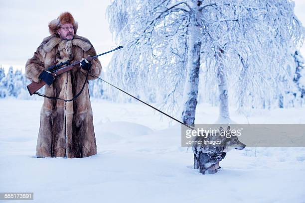 mature man walking dog at winter - hairy man stock pictures, royalty-free photos & images