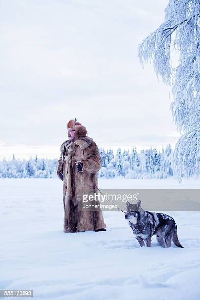 Mature man walking dog at winter