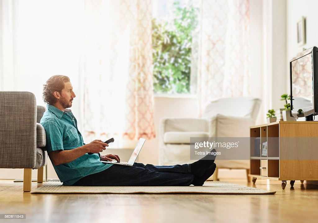 Mature man watching tv : Stock Photo