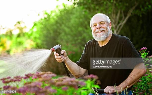 Mature Man Watering Plants