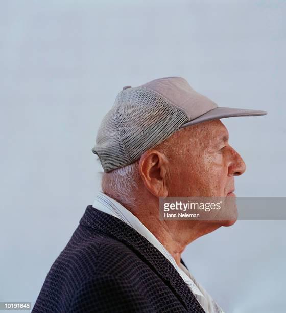 Mature man wearing baseball cap, profile, close-up