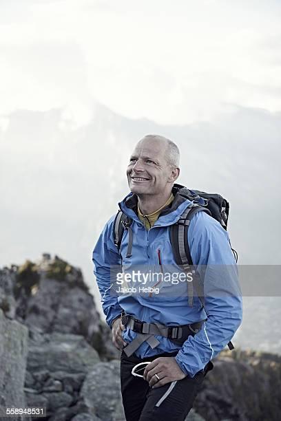 Mature man wearing blue jacket, portrait