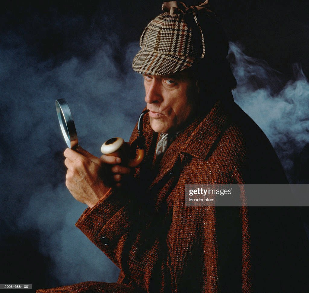 Mature man wearing cap and cape, holding pipe and magnifying glass : Stock Photo