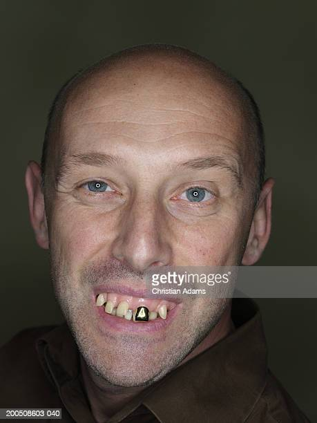 mature man wearing fake teeth, close-up, portrait - ugly bald man stock photos and pictures