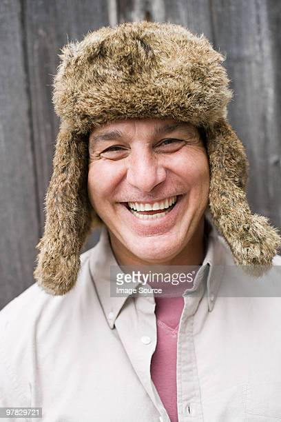 mature man wearing fur hat - fur hat stock photos and pictures