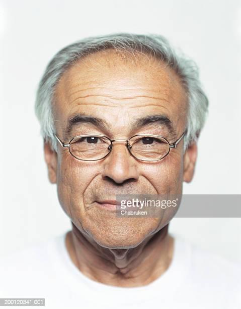 Mature man wearing glasses, portrait