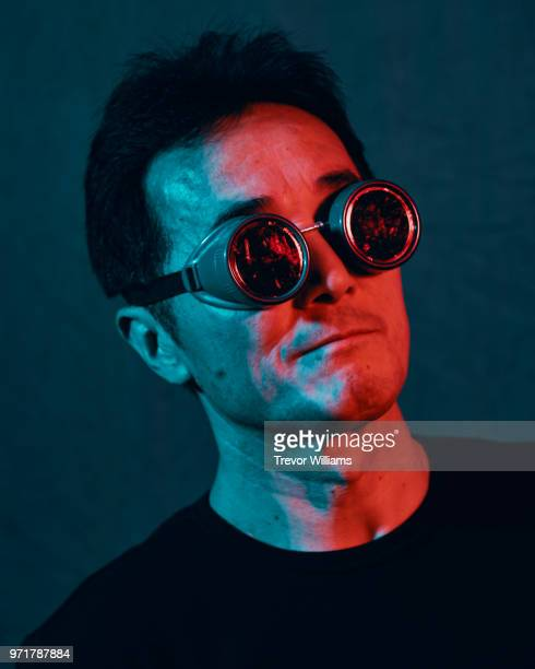 mature man wearing goggles with a confident expression - fine art portrait stock pictures, royalty-free photos & images