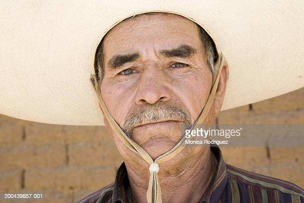 Mature man wearing hat, close-up