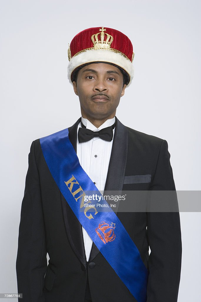 Mature man wearing king's crown and sash, portrait : Stock Photo