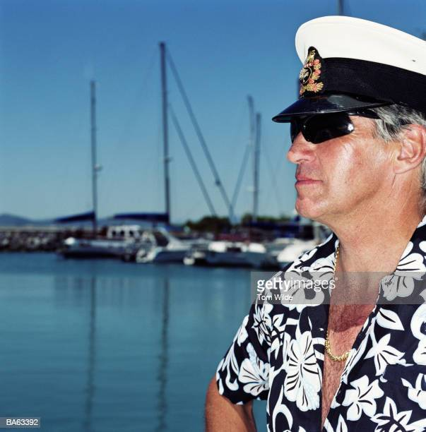 mature man wearing sailors cap, outdoors - sailor hat stock pictures, royalty-free photos & images