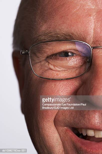 Mature man wearing spectacles, smiling, portrait, close-up of face