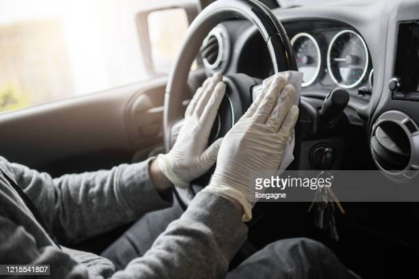 mature man wiping down surfaces - driving mask stock pictures, royalty-free photos & images