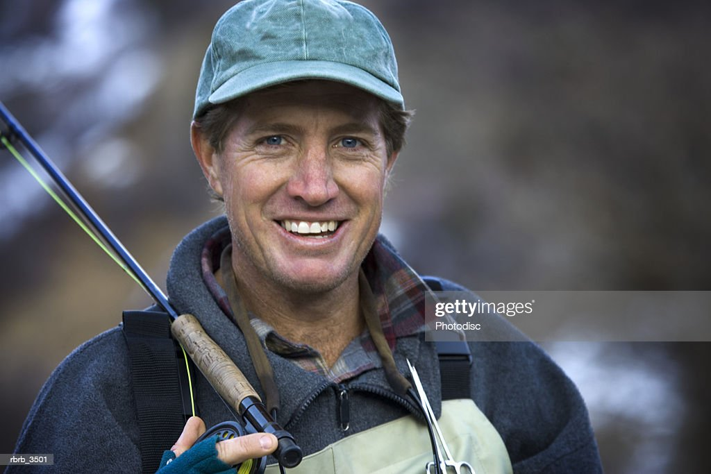 Mature man with a fishing rod : Stockfoto