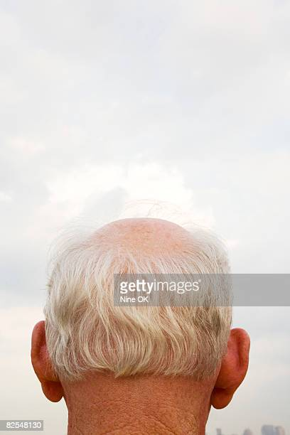 Mature man with balding spot
