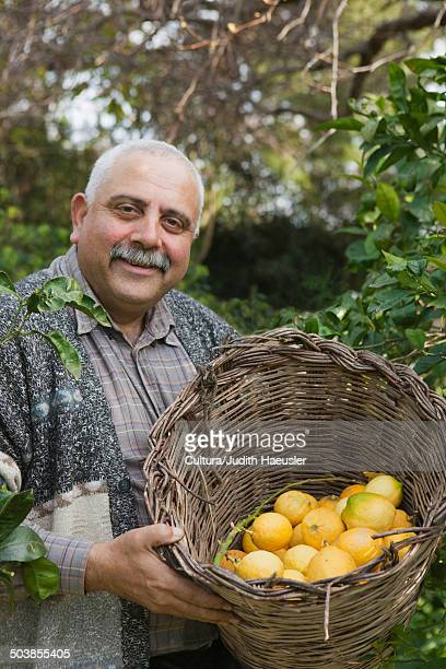 mature man with basket of lemons