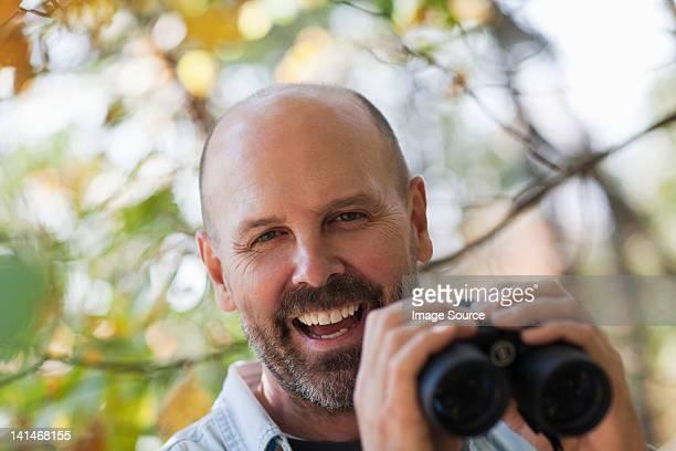 Mature man with binoculars