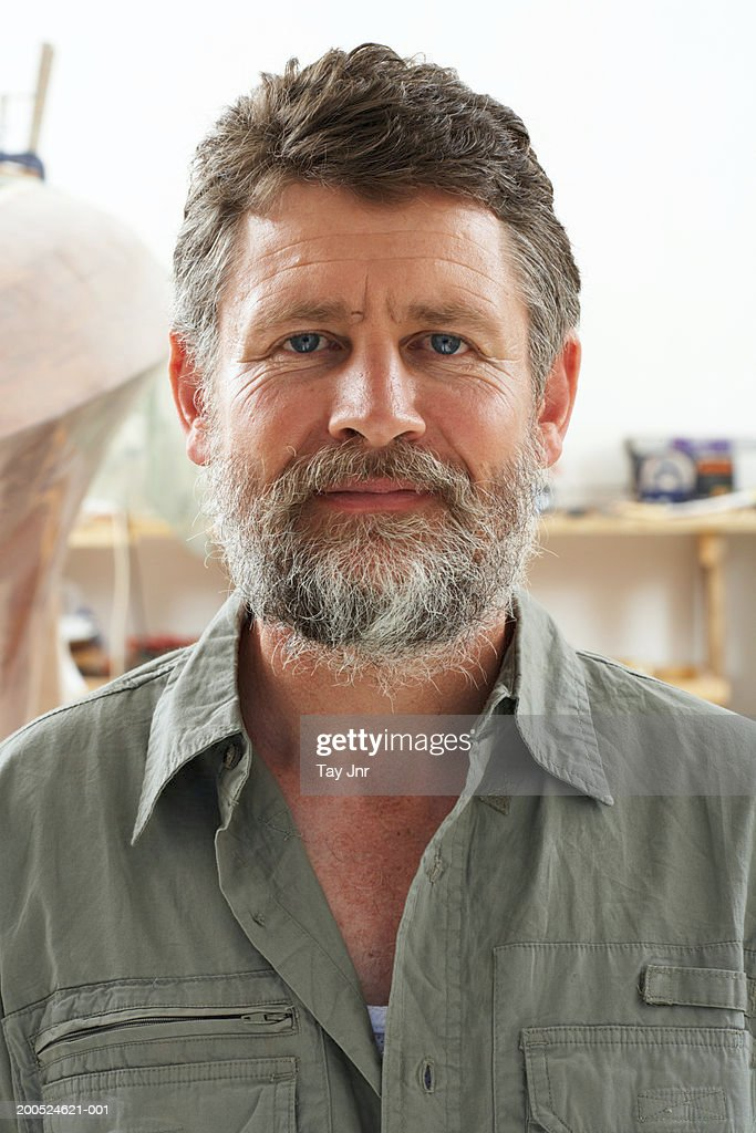 Mature man with boat in background, close-up, portrait : Stock Photo
