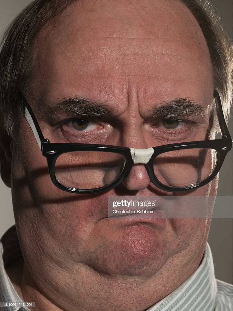 Mature man with broken glasses, portrait, close-up : Stock Photo