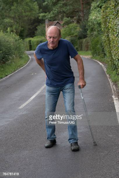 mature man with cain - struggle stock pictures, royalty-free photos & images