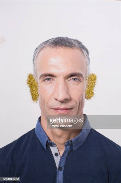 Mature man with gold ears