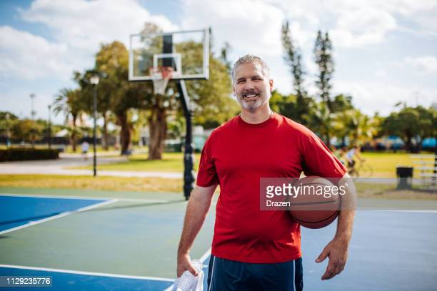 mature man with gray hair playing basketball in usa - weight loss stock pictures, royalty-free photos & images